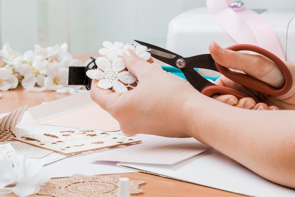 Person cutting flower designs