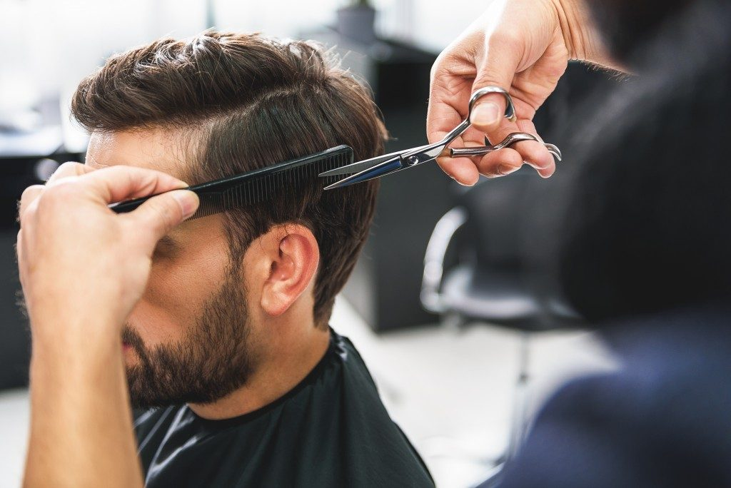 Man getting a haircut before the photoshoot