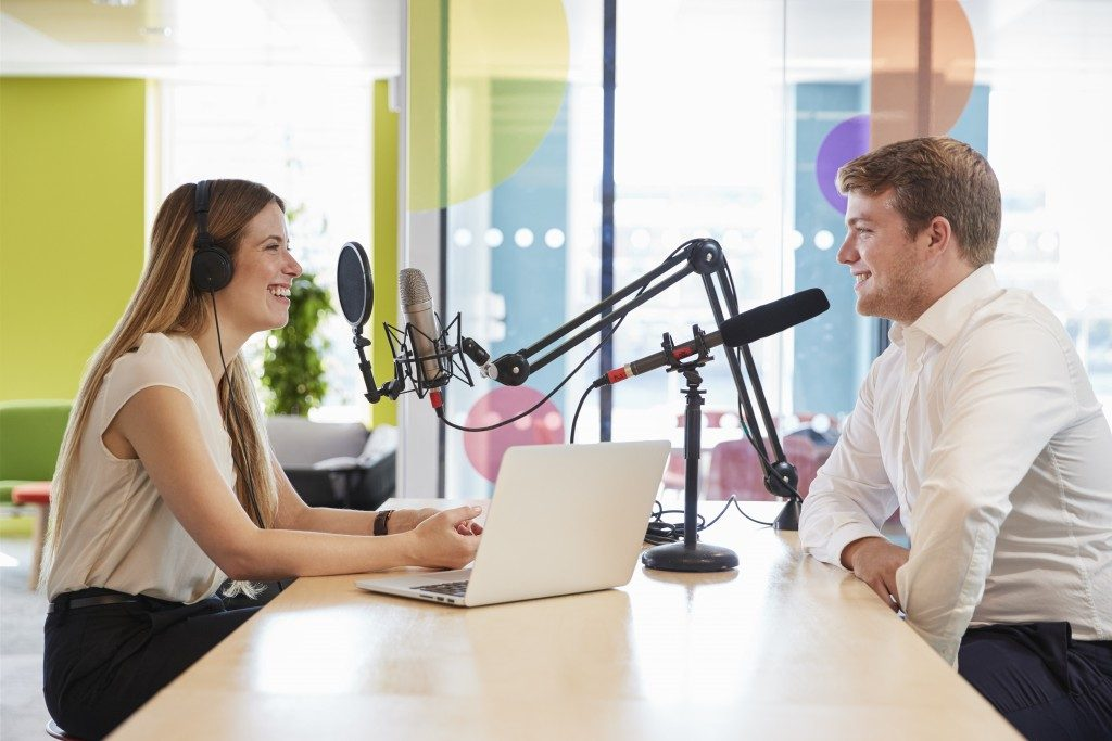 Man and woman having a radio conversation