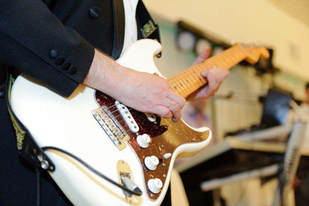 musician playing rock guitar