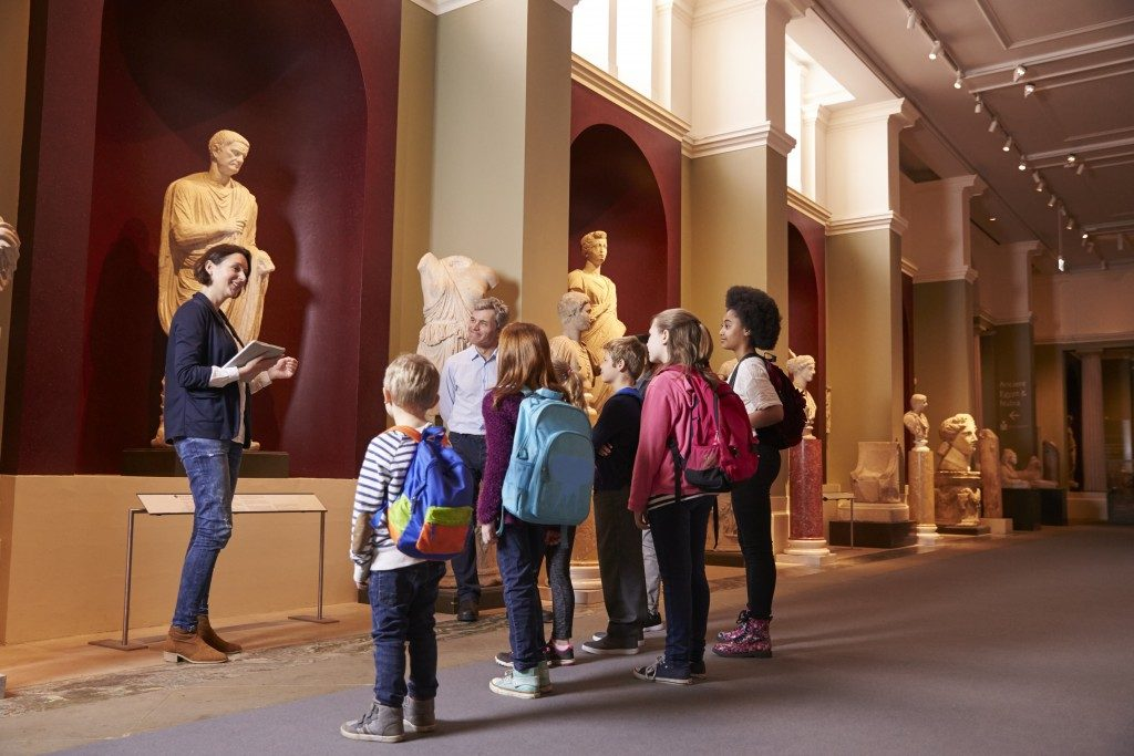 teacher and students in a museum field trip